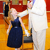 Don Knight | The Herald Bulletin<br /> Alexandria Intermediate School principal Mark Bartmas asks Susie Clark to sit on her throne on Monday. Burger King provided 500 crowns for the school's Prince and Princess Day.