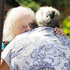 Don Knight | The Herald Bulletin<br /> Mary Simpson hugs her mother Sibyl after Sibyl and her two dogs were rescued from a house fire on East 10th Street on Tuesday.