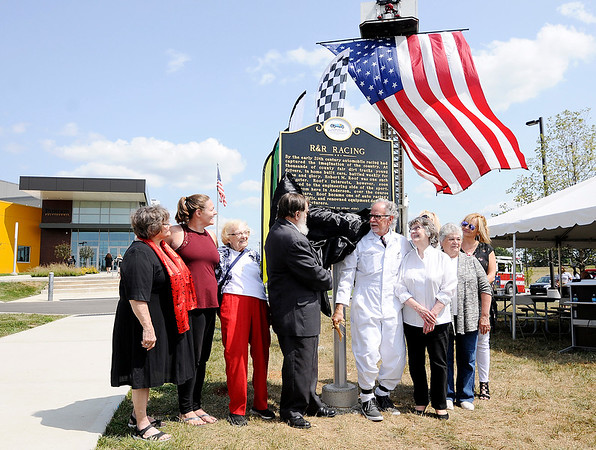 Don Knight | The Herald Bulletin<br /> Family members of Robert Roof and Myron Reynolds unveil a memorial marker for R&R Manufacturing at Flagship East / Purdue Polytechnic Anderson on Friday.