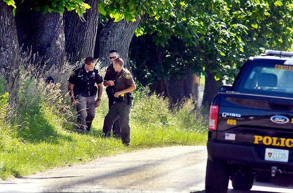 John P. Cleary    The Herald Bulletin<br /> Law enforcement officers continued to look for evidence Wednesday in the area of County Road 1400 North and Ind. 9 where a man was found in a vehicle shot nine times early Wednesday morning.