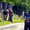 John P. Cleary |  The Herald Bulletin<br /> Law enforcement officers continued to look for evidence Wednesday in the area of County Road 1400 North and Ind. 9 where a man was found in a vehicle shot nine times early Wednesday morning.