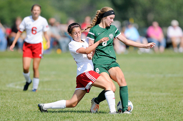 Don Knight   The Herald Bulletin<br /> West Lafayette's Catalina Posada challenges Pendleton Heights Anna Childers for the ball during the Arabians soccer invitational on Saturday.