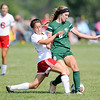 Don Knight | The Herald Bulletin<br /> West Lafayette's Catalina Posada challenges Pendleton Heights Anna Childers for the ball during the Arabians soccer invitational on Saturday.