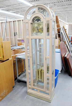Don Knight | The Herald Bulletin<br /> A grand father clock waits to be moved out on the sales floor at the Habitat for Humanity ReSale Store in Chesterfield on Thursday. Proceeds from the store fund Habitat for Humanities building projects.