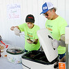 Don Knight | The Herald Bulletin<br /> David and Teresa Barnett serve hamburgers and hotdogs during a St. Jude Benefit at Northgate True Value on Saturday.
