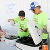 Don Knight | The Herald Bulletin<br /> David and Teresa Barnett serve hamburgers and hotdogs during a St. Jude Benefit at Northgate True Value on Saturday.