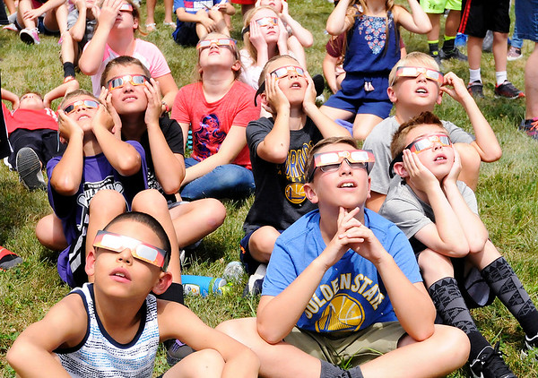 Don Knight   The Herald Bulletin<br /> Students at Lapel Elementary watch the solar eclipse on Monday. The next eclipse for Indiana will be in 2024.