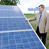 Don Knight | The Herald Bulletin<br /> Sheridan superintendent Doug Miller stands next to the solar panel array at Sheridan Elementary School. Frankton-Lapel Community Schools, Madison-Grant United School Corp. and Elwood Community Schools have solar projects in the works.