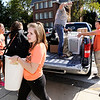 Don Knight | The Herald Bulletin<br /> Hannah Scott helps incoming freshman Troy Hochstetler move into Dunn Hall at Anderson University on Thursday. Classes resume on Monday.
