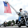 Don Knight | The Herald Bulletin<br /> Motorcyclists pass under an American flag displayed by AFD on 53rd Street during the 12th annual Jessica & Lynsey Memorial Ride on Saturday. It pays tribute to murder victims Jessica Lyons, 13 when she was killed in 2000, and Lynsey Schildmeier, who was 20 when she was slain in 2006.