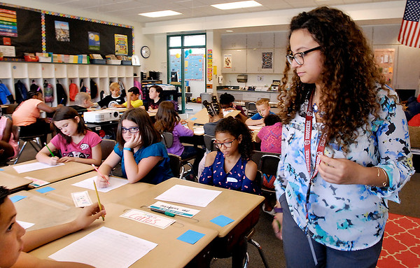 John P. Cleary |  The Herald Bulletin<br /> New Anderson Community Schools 4-grade teacher Romelie Pitts goes around her Erskine Elementary School room to check on students  as they do a word exercise Wednesday on the first day of class.