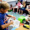 Don Knight | The Herald Bulletin<br /> Dylan John, 9, cuts out the moon to create a model of the earth, moon and sun Pamela Kittle's fourth grade class on Friday.