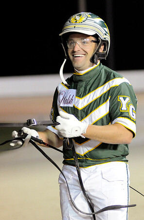 Don Knight   The Herald Bulletin<br /> Driver Yannick Gingras smiles as he arrives at the winner's circle after winning the Dan Patch Stakes with Check Six at Hoosier Park on Friday.