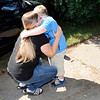 Don Knight   The Herald Bulletin<br /> Kelly McCoy-Brown hugs her son Trenton as he arrives home from school on Thursday. When Trenton was diagnosed with Schizencephaly, his parents were told he would likely remain in a vegetative state, but he is living an active life including going to school and playing sports.