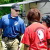 John P. Cleary |  The Herald Bulletin<br /> Anderson Police Department detective Mark Brizendine talks with members of the neighborhood crime watch group at the Belmont Block Party held earlier this month. Brizendine works in the community oriented policing unit of APD.