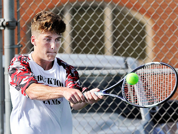John P. Cleary | The Herald Bulletin<br /> Frankton's #1 singles Andrew Hartley returns a shot in his match with Shenandoah's Cory Evans.