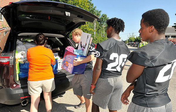 John P. Cleary | The Herald Bulletin<br /> Members of the Anderson University football team lineup to help unload vehicles on move-in day for incoming freshman Thursday at Dunn Hall.