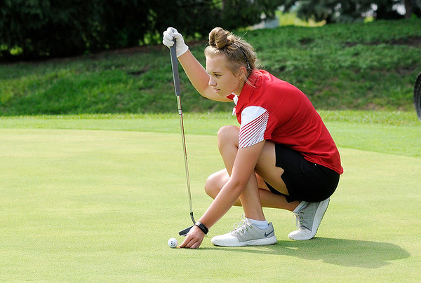 Don Knight | The Herald Bulletin<br /> Frankton's Sydney Dillmon marks her ball on the second green as the Eagles hosted Anderson at the Meadowbrook Golf Course on Wednesday.