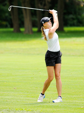 Don Knight | The Herald Bulletin Pendleton Heights Daniel Tinsley watches her approach shot into the first green during the Lapel Bulldog Invitational at the Edgewood Golf Course on Saturday.