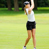 Don Knight | The Herald Bulletin<br /> Pendleton Heights Daniel Tinsley watches her approach shot into the first green during the Lapel Bulldog Invitational at the Edgewood Golf Course on Saturday.