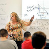 John P. Cleary   The Herald Bulletin<br /> Anderson High School geometry teacher Deanna House goes through a math problem with her students.