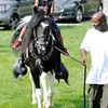 "Don Knight | The Herald Bulletin<br /> Cy'ier Poore, 4, rides Milky Way as the horse is lead by Willie ""Duck"" Currie during The Madison County Community Health Center's 15th Annual Back Yard BBQ on Friday as part of National Health Center Week."