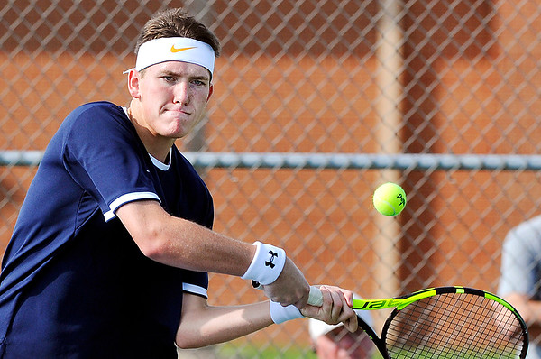 John P. Cleary   The Herald Bulletin<br /> Shenandoah's #1 singles Cory Evans returns a two-handed backhand shot in his match with Frankton's Andrew Hartley.