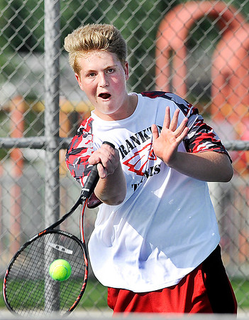 John P. Cleary | The Herald Bulletin<br /> Frankton's #2 singles Brad Riser returns a shot in his match with Shenandoah's Lance Holdren.