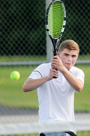 Don Knight | The Herald Bulletin<br /> Lapel's Ian Vipperman defeats Eastern Hancock's Kegan Kendall 6-3, 6-1 in his first varsity singles match on Wednesday.