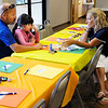 Don Knight | The Herald Bulletin<br /> Shelly Ross tells Todd Naselroad and his daughter Gracie about what Intersect does during a community gathering held by the Northern Madison County Drug Prevention Coalition held in Alexandria on Tuesday.