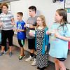 Don Knight | The Herald Bulletin<br /> Students in Athena Matlock's class use flash cards during a review of syllable types at East Elementary on Friday.