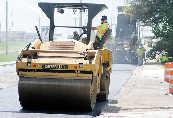 Don Knight | The Herald Bulletin<br /> A crew from Milestone puts down a base layer of asphalt on Dr. Martin Luther King Boulevard from Madison Avenue to 25th Street on Wednesday. Weather permitting a topcoat will be put down today.