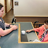John P. Cleary | The Herald Bulletin<br /> Eulala Roettger, 99, right, has been a volunteer receptionist at the Erskine Medical Building at St. Vincent Anderson for the last 20 years. Here Eulala talks with Christeena Simmons, medical assistant for Dr. Hazim Rimawi, as she stops by during her lunch break.