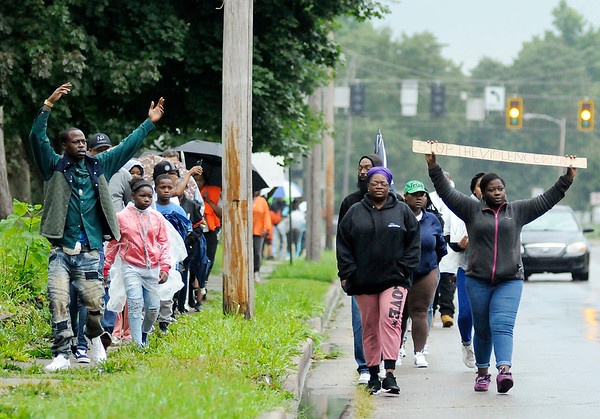 Don Knight   The Herald Bulletin<br /> Around 50 family and friends of Jeremy Boyd, who was shot to death outside his home Aug. 17, walk down Nichol Avenue during a Peace Walk in remembrance of Boyd on Saturday.
