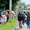 Don Knight | The Herald Bulletin<br /> Around 50 family and friends of Jeremy Boyd, who was shot to death outside his home Aug. 17, walk down Nichol Avenue during a Peace Walk in remembrance of Boyd on Saturday.