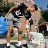 John P. Cleary | The Herald Bulletin<br /> Anderson University football player Elijah Growe grabs a hand full of clothes as he and his teammates help incoming freshman move in to Dunn Hall Thursday during move-in day for the new students.