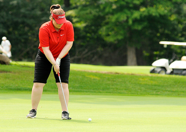 Don Knight | The Herald Bulletin<br /> Anderson's Claire Mountcastle putts on the fourth green at Walnut Creek Golf Course during the Madison County Golf Tournament on Saturday.