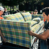 John P. Cleary | The Herald Bulletin<br /> Anderson University volunteers unload a couch for a incoming freshman for his dorm room during move-in day Thursday at Dunn Hall.
