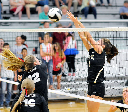 John P. Cleary | The Herald Bulletin<br /> Lapel's Zoe Freer, right, blocks a shot from Daleville's  Abbie Lee at the net.