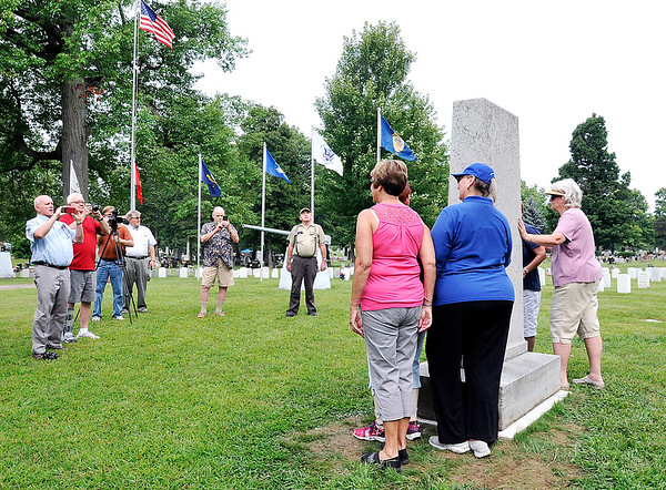 John P. Cleary   The Herald Bulletin<br /> Members of the Kikthaweund DAR Chapter get their picture taken next to the Anderson High School World War I monument that they helped get relocated to the Veterans section of East Maplewood Cemetery from the old high school lawn on Lincoln Street.