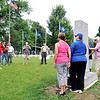 John P. Cleary | The Herald Bulletin<br /> Members of the Kikthaweund DAR Chapter get their picture taken next to the Anderson High School World War I monument that they helped get relocated to the Veterans section of East Maplewood Cemetery from the old high school lawn on Lincoln Street.