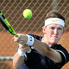 John P. Cleary | The Herald Bulletin<br /> Shenandoah's #1 singles Cory Evans returns a two-handed backhand shot in his match with Frankton's Andrew Hartley.