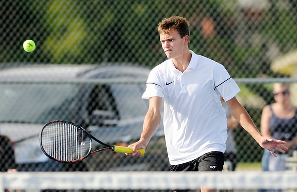 Don Knight   The Herald Bulletin<br /> Lapel's Reid Ratzlaff returns the ball as Ratzlaff and Ross Hagen faced Eastern Hancock's Keegan Bowman and Brody Ellis in the No. 1 doubles match on Wednesday.