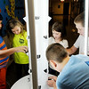Don Knight   The Herald Bulletin<br /> Clockwise from left, Antonio Robles, Miley Sylvia, Bella Crouse, Riddick Allison and Logan Parker install planting cups in a Tower Garden at Liberty Christian on Tuesday.