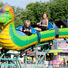 Don Knight | The Herald Bulletin<br /> Kids ride a roller coaster in the midway at Callaway Park during the Elwood Glass Festival on Friday. The festival continues through Sunday. You can find a schedule of events at elwoodglassfestival.com.