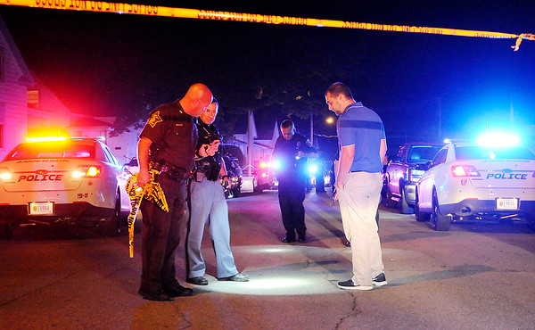 Don Knight   The Herald Bulletin<br /> APD with help from the Madison County Sheriff's Department and State Police secure the scene of shooting on 12th Street west of Sheridan Street Saturday night.