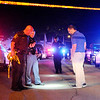 Don Knight | The Herald Bulletin<br /> APD with help from the Madison County Sheriff's Department and State Police secure the scene of shooting on 12th Street west of Sheridan Street Saturday night.