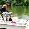 Don Knight | The Herald Bulletin<br /> Demetrius Stokes fishes from the dock at Shadyside Lake on Tuesday. Stokes caught several bluegill and a nice crappie fishing with minnows around the dock.