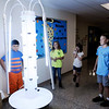 Don Knight | The Herald Bulletin<br /> From left, Antonio Robles, Miley Sylvia, Bella Crouse and Logan Parker look at the Tower Garden they assembled at Liberty Christian on Tuesday.