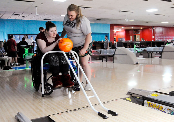 Don Knight   The Herald Bulletin<br /> Devin Morris helps Angel McCarter bowl during an outing to Championship Lanes on Thursday.